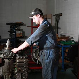 Employee inspecting an engine